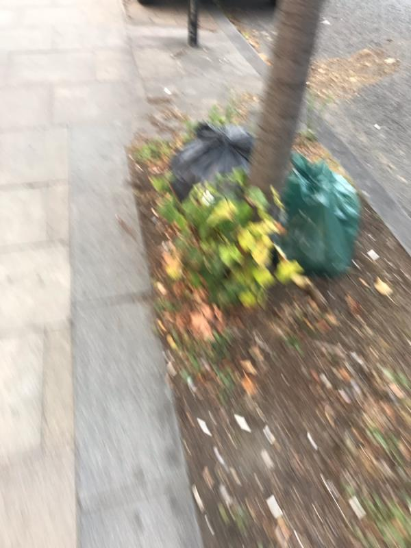 Fly tipped bags are dumped outside 273 Greenford Road Ub6 -273 Greenford Road, London, UB6 8QZ