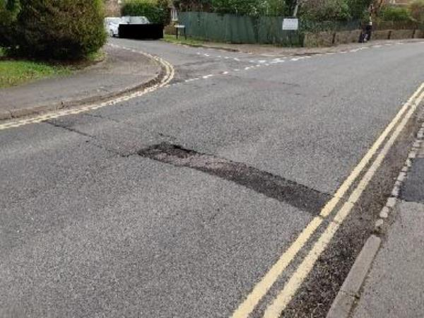 poor road condition after road had been dug up and filled in by a utility company. they should be held accountable for a more satisfactory job???-91 Mill Road, Burgess Hill, RH15 8EG