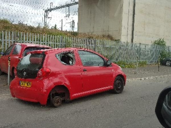 abandoned car on actual road, can cause accident-47 Loverock Road, Reading, RG30 1DZ