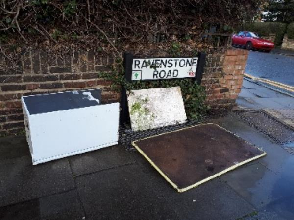 dumped refrigerator, two pieces of panels, some wire fencing-39 Alexandra Road, London, N8 0PP