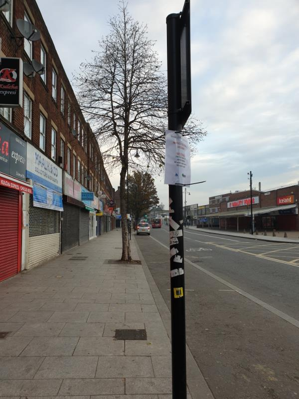 flyposters and stickers on columns on 8 columns-90 South Rd, Southall UB1 1RD, UK