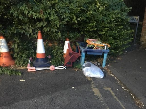 Fly tipping on road, please take cones too. They have been there for a year -19 Hart Street, Reading, RG1 7PG