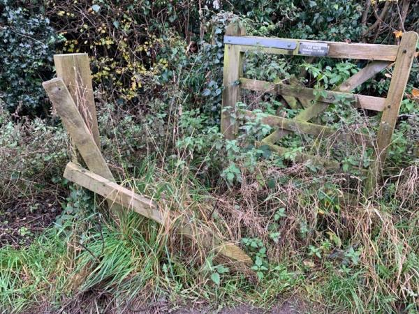 Damaged footpath stile . Cheshire county council badge on gate.-Marloes Village Road, Chester, CH3 7QN