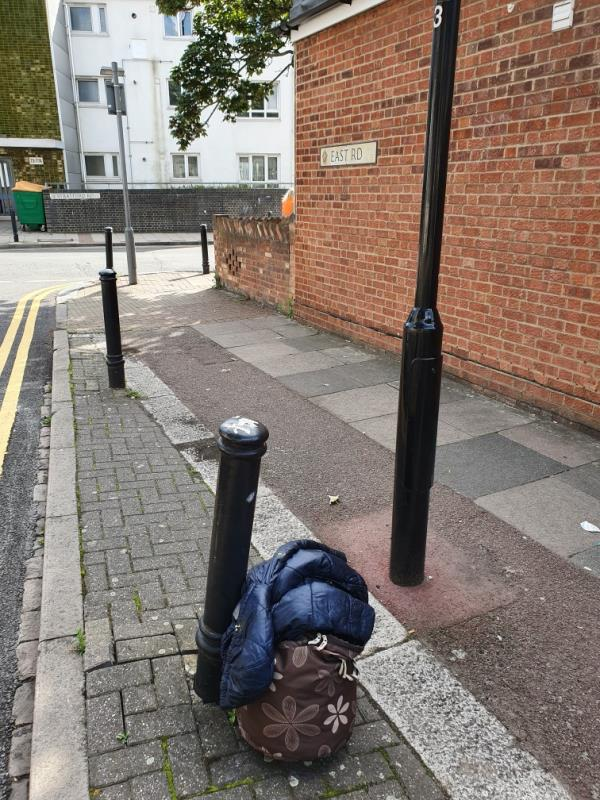 Bag and a jacket on a corner of the street-80 East Road, London, E15 3QR
