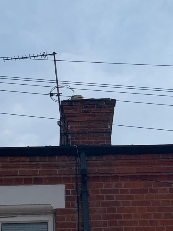 Chimney bricks dangerously loose. Hazard of falling into street or onto tenant. Landlord was contacted but isn't taking action, however it is really dangerous for people walking past the house. A builder highlighted the problem, and said it needs sorting as soon as possible. image 1-50 Bede Street, Leicester, LE3 5LD