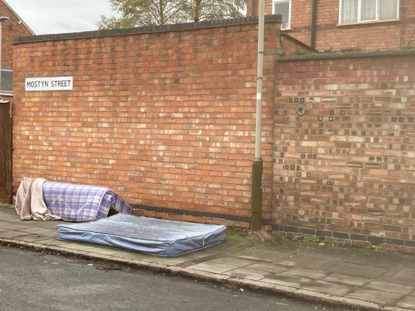 Two of three mattresses on Mostyn St near to the junction of Denton St-43 Mostyn Street, Leicester, LE3 6DX