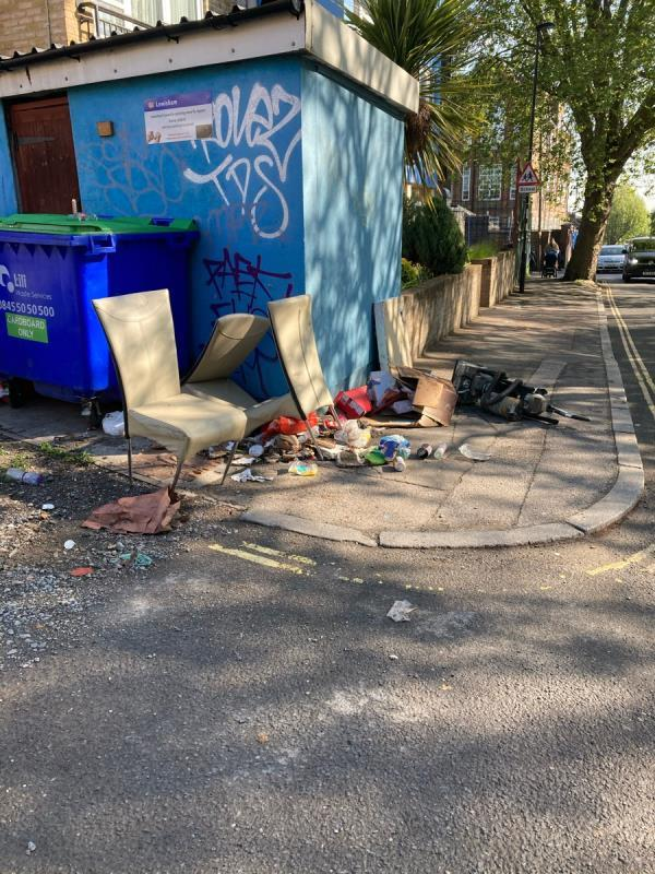 Leak from red gate. Premises belong to business on Lewisham way. Plus fly tipping outside block of flats near open bin stored. Rubbish dumped yesterday.  image 1-48 Lucas Street, London, SE8 4QH