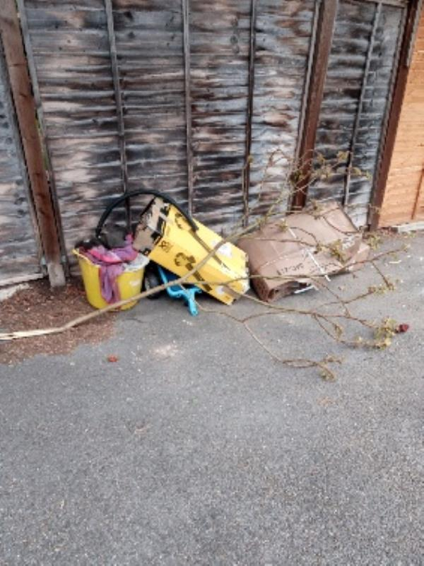 Cardboard box and other items dumped by the garages -10 Heron Way, Reading, RG1 6DY