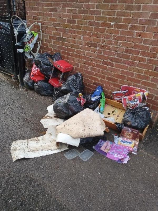 fly tipping by block Aveley Walk -2 Spring Gardens, Reading RG2 0AQ, UK