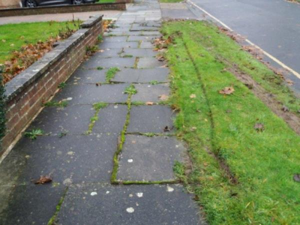 Paving slabs broken on public pathway outside number . -15 Stonefield Close