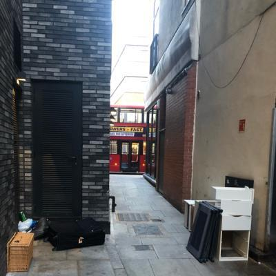 Lots of fly tipping.  Old furniture, bags, basket and trash-115 Curtain Road, London, EC2A 3BF