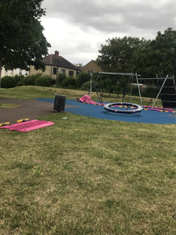 All covid fencing down and bust open on equipment, is the fencing just for show purposes? Exercise bars and climbing equipment in use by public. Also climbing frame removed but fencing left behind. Looks a mess . Location Odessa Open Space -95 Odessa Road, London, E7 9BL