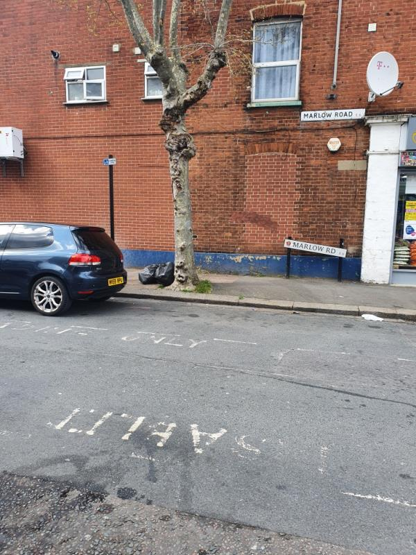 Dumped near junction with High Street South as base of tree-2 Hollington Road, East Ham, E6 3RW