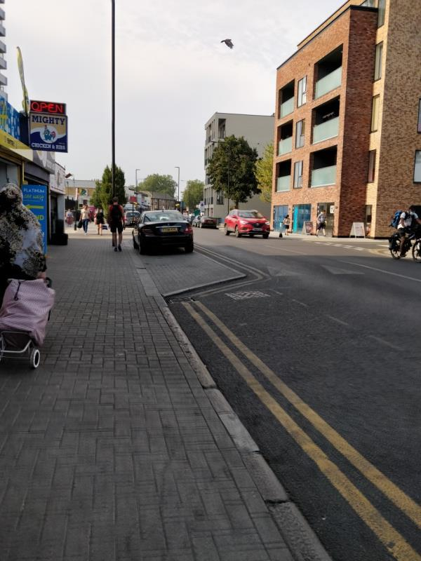 Car illegally parked on the pavement beside 113 Leytonstone Road E15-113 Leytonstone Road, London, E15 1JA