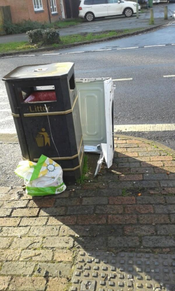 washing machine housing put by side of bin by bus stop on Mayfield road opposite chaucer road entrance -10 Chaucer Road, Farnborough, GU14 8SW