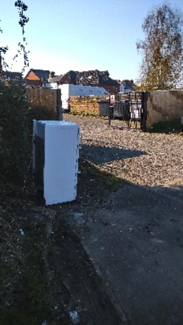A collection or flytipped fridge? If flytipped needs  two man lift-62 Wincanton Road, Reading, RG2 8PB