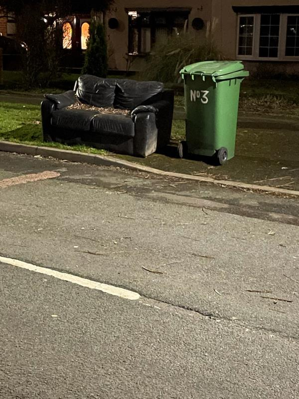 Sofa fly tipped on grass verge-3 Parklands Road, Wolverhampton, WV1 2DP