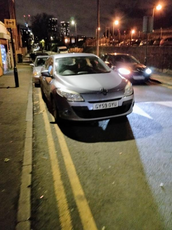 Car illegally parked on double yellow lines at the corner of Maryland Road off Leytonstone Road E15-52 Leytonstone Road, London, E15 1JA