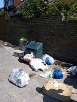 fencing concrete slabs bags of clothing cardboard and packaging  image 1-4 Prospect Close, London, SE26 6LE
