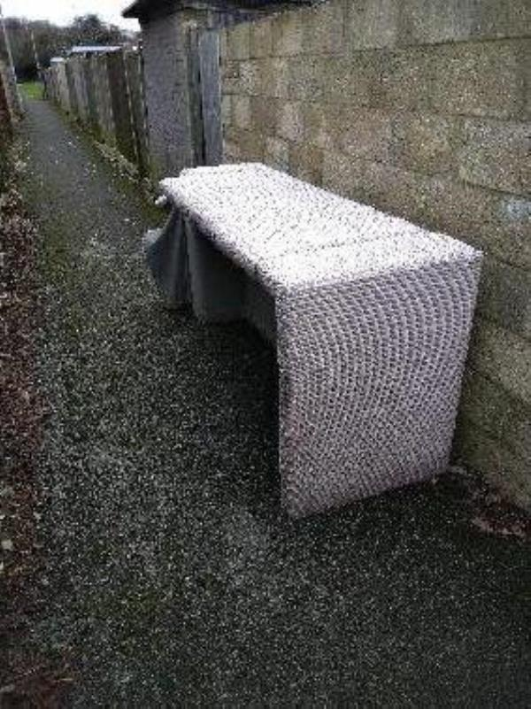 A  sofa has been fly tipped in the footpath between the backs of the houses of lexington Grove and sampage Close near the bus stop in Swallowfield drive -1 Lexington Grove, Reading, RG2 8UG