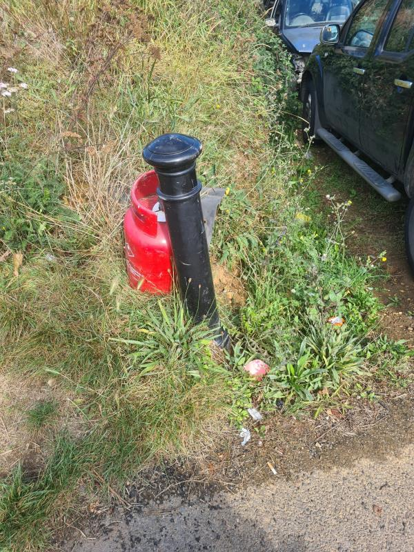 Red Gas Canister dumped on public land outside 62 Lyndhurst.  Seems to be commercial waste from the garage operating there!-127 Lyndhurst Road, Reading, RG30 6TX