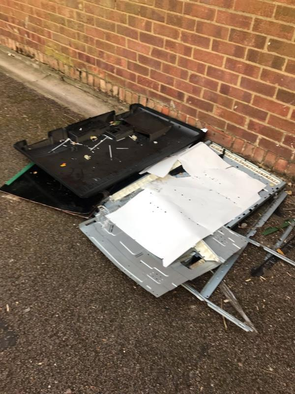 Disassembled and discarded flat screen TV at the entrance to the footpath close to Croombs Road.-86 Croombs Road, London, E16 3RZ