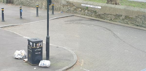 Bins overflowing and 3 extra bags of litter on the pavement.-17 Elmgreen Close, London, E15 4BS