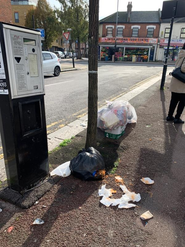 Bags of rubbish left by irking meter. Full of rotting food and bursting open. -637a Romford Road, London, E12 5AD