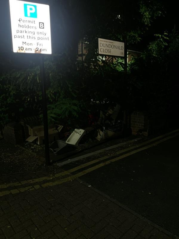 Fly tipped sink and bags of rubbish at entrance to Dundonald Close-55 Northumberland Road, London, E6 5RN